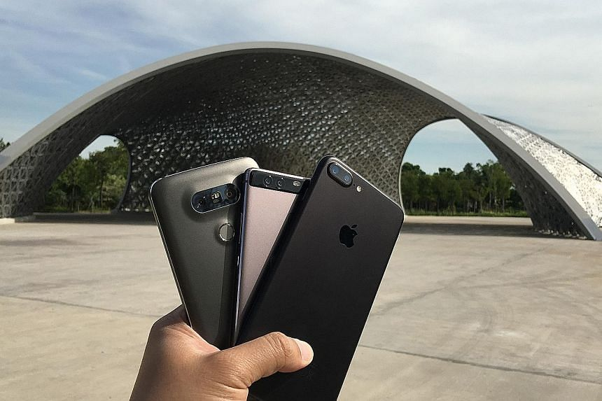 Smartphone makers are putting dual-lens camera systems into their flagship phones to attract customers.