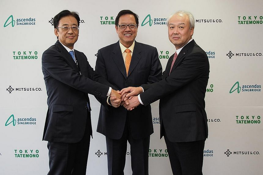 Ascendas-Singbridge Group has entered into a joint venture for the 79 Robinson Road project with Mitsui & Co and Tokyo Tatemono, as represented by (from left) Mr Nishimura, Mr Ko and Mr Tanehashi.
