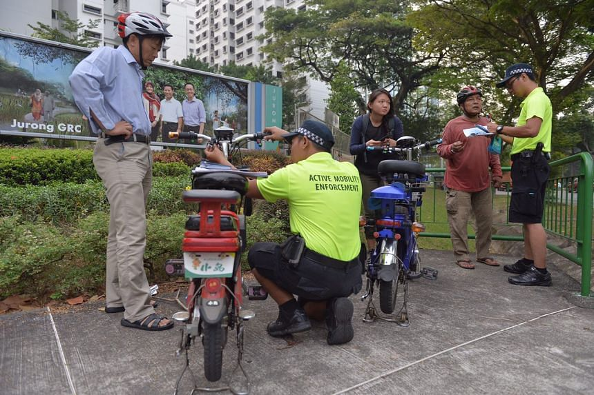 LTA enforcement officers checking for illegally modified e-bikes along Corporation Road.