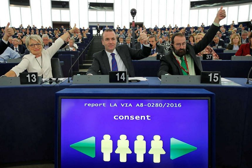 European Parliament members vote in favour of the Paris UN COP 21 Climate Change agreement at the European Parliament in Strasbourg, Oct 4, 2016.
