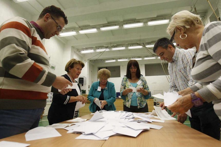 Members of a local election commission start counting votes after the polling station closed in Budapest, Hungary, Oct 2, 2016.