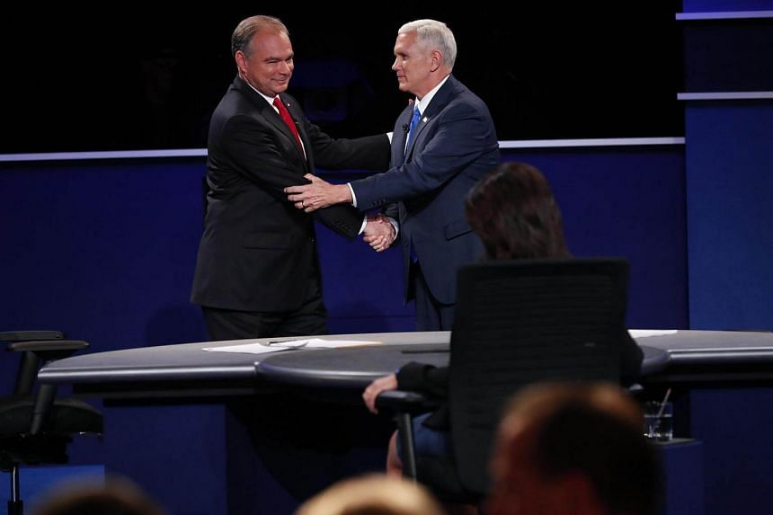 Tim Kaine (left) and Mike Pence shake hands after their vice-presidential debate at Longwood University in Farmville.