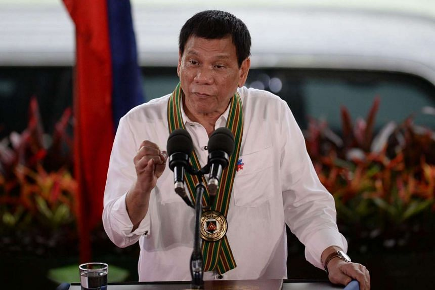 Philippine President Rodrigo Duterte gestures as he delivers a speech during a talk to the troops visit to meet military personnel in Manila.