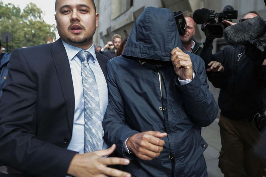 Mazher Mahmood (right) is pictured with a hood over his face as he leaves the Old Bailey Central Criminal Court in central London on Oct 5, 2016.