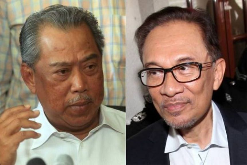 Jailed opposition leader Anwar Ibrahim (right) and Tan Sri Muhyiddin Yassin met to discuss cooperation between their political parties.