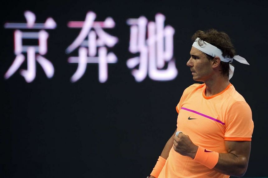 Nadal celebrates winning a point against Paolo Lorenzi of Italy.