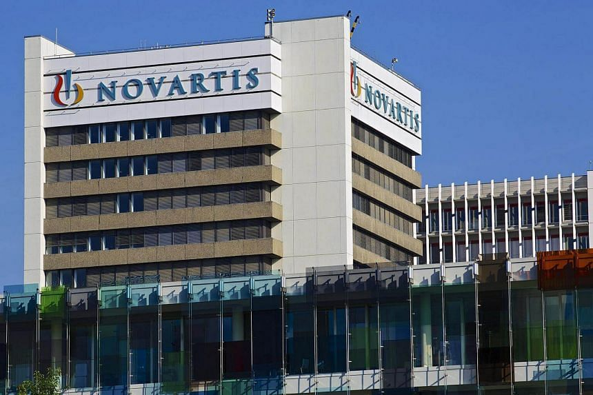 Logos sit above windows at Novartis AG's headquarters in Basel, Switzerland.