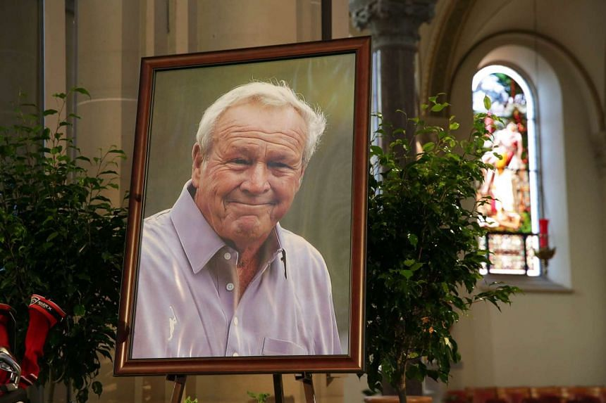 Arnold Palmer's portrait is displayed on the altar during the memorial service on Oct 4, 2016 in Latrobe, Pennsylvania.