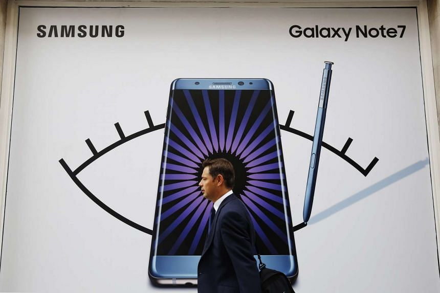 A man walks past an advertisement for the Samsung Galaxy Note 7 in London.