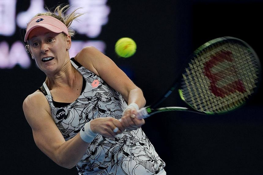 Alison Riske (pictured) of the US hits a return to Zhang Shuai of China during their women's singles second round match of the China Open tennis tournament in Beijing on Oct 4, 2016.