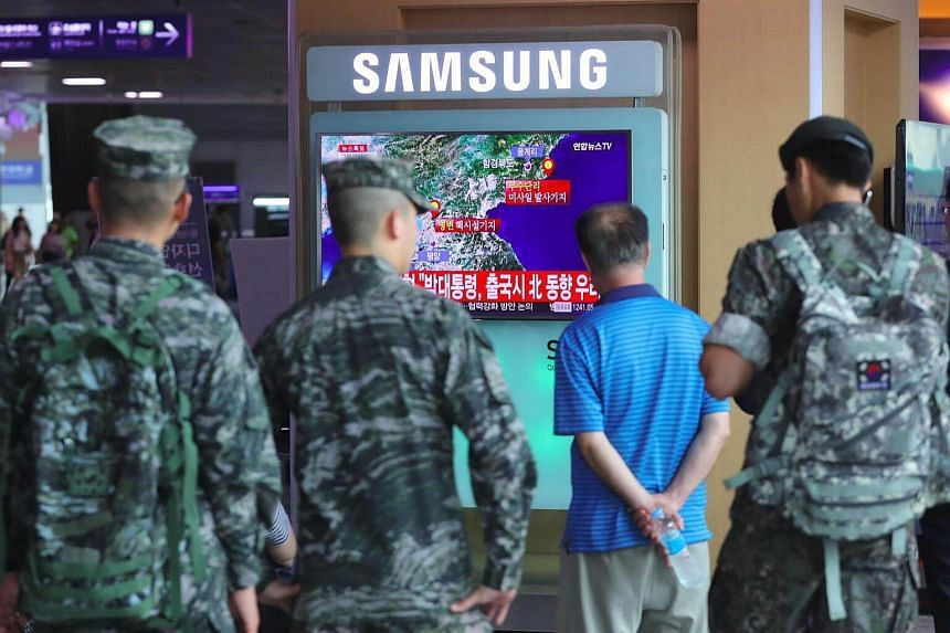 South Korean soldiers watching a television broadcast reporting on North Korea's latest nuclear test, at a railway station in Seoul on Sept 9, 2016.