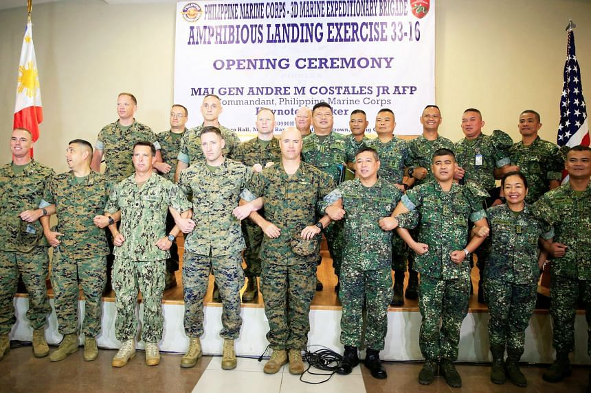 United States Marine Corps and Philippine Marine Corps personnel linking arms yesterday during the opening ceremony of the annual Philippines-US amphibious landing exercise. Military leaders from both sides continue to emphasise the strong bilateral ties
