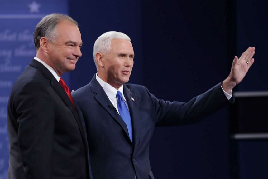 Tim Kaine (left) and Mike Pence on stage prior to the Vice-Presidential Debate on Oct 4, 2016.