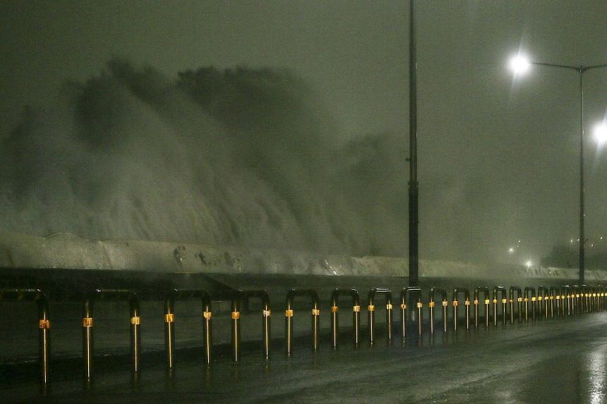 High waves rise over a road as Typhoon Chaba approaches Jeju Island, South Korea, on Oct 5, 2016.