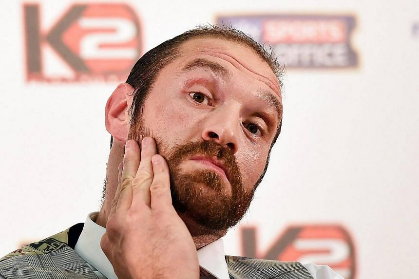 A file photograph showing British heavyweight boxer Tyson Fury reacting during a press conference in London.