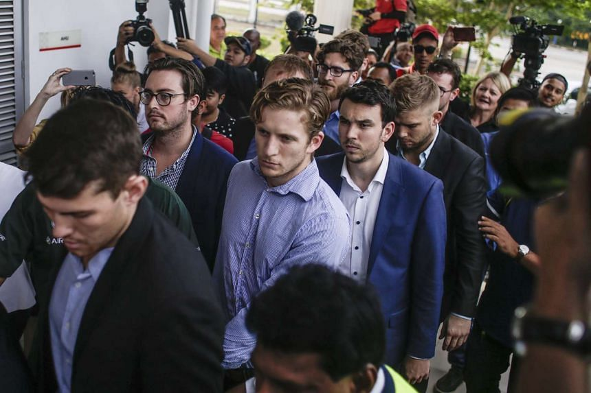 The nine Australian men who stripped down to Malaysian flag briefs arriving at Sepang Magistrate Court on Oct 6, 2016.