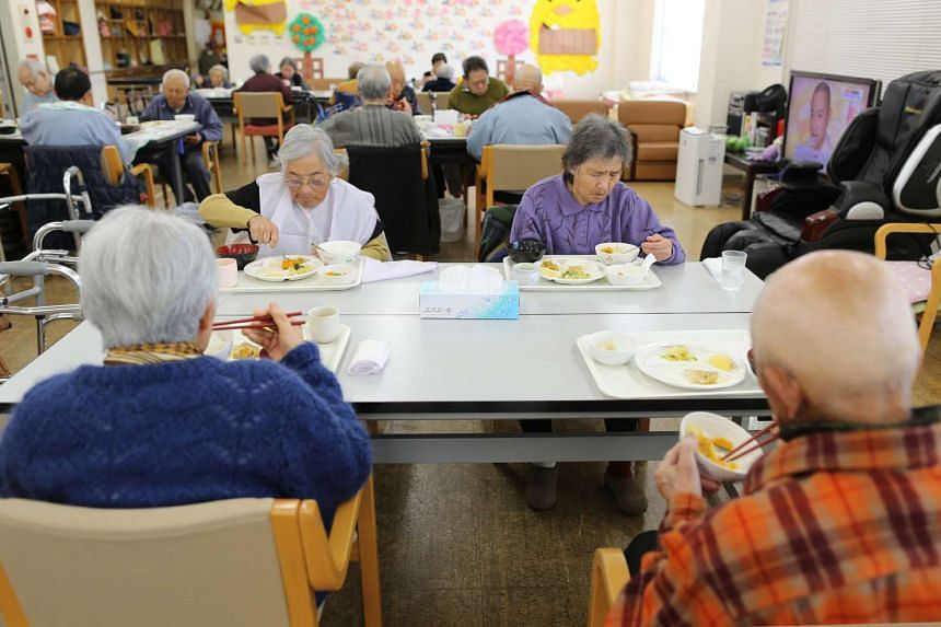 Elderly people at a day care facility on Gogo Island in Ehime Prefecture, Japan, on March 22, 2013.