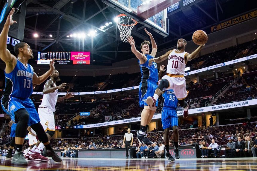 Markel Brown of the Cleveland Cavaliers passes around Stephen Zimmerman Jr. of the Orlando Magic during a preseason game on Oct 5, 2016 in Cleveland, Ohio.