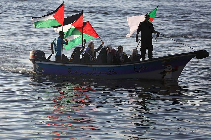 Palestinian women show their solidarity with a Gaza bound flotilla during a rally in the west of Gaza on Oct 5, 2016.