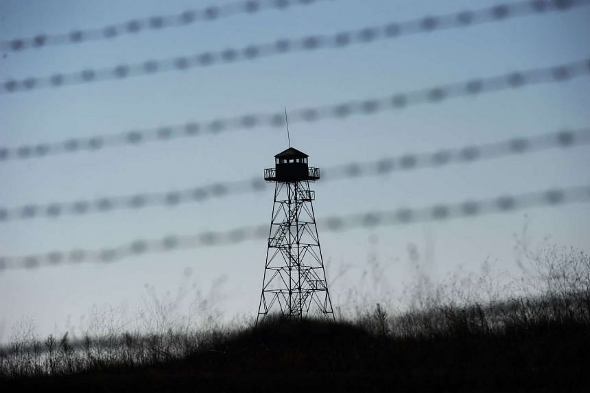 A watchtower behind a barbed wire fence near the Kapitan Andreevo border crossing point between Bulgaria and Turkey.