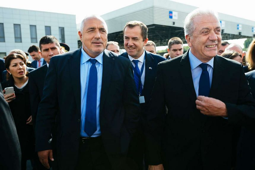 EU Migration Commissioner Dimitris Avramopoulos (right) and Bulgarian Prime Minister Boyko Borisov at the inauguration ceremony of the new European Border and Coast Guard task force at the Kapitan Andreevo checkpoint on Oct 6, 2016.