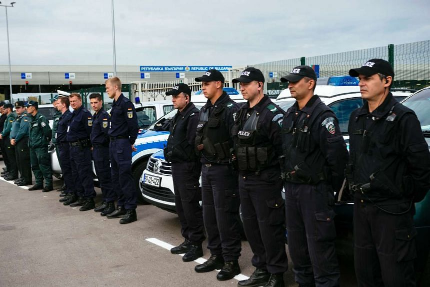 German policemen, Bulgarian Border guards and members of the new European Border and Coast Guard task force attend an inauguration ceremony at the Kapitan Andreevo checkpoint on Oct 6, 2016.
