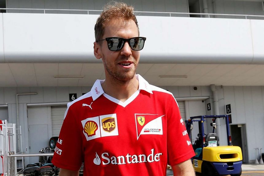 Ferrari's Sebastian Vettel was hit with a three-place penalty for this weekend's Japanese race after he collided with Nico Rosberg's Mercedes.
