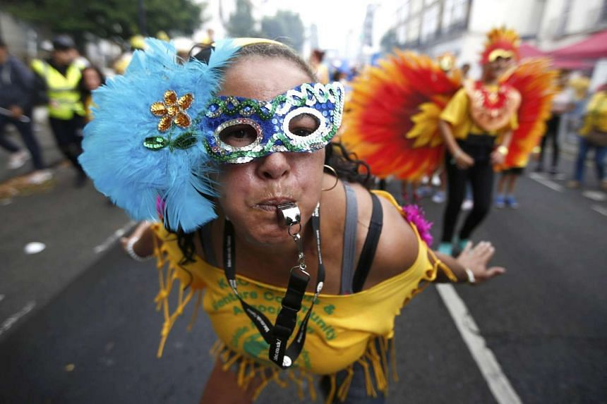 Performers participate in the children's day parade at the Notting Hill Carnival in London on Aug 28, 2016.