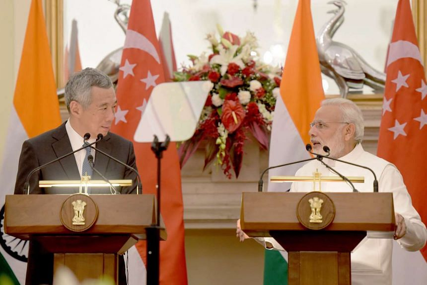 Singapore PM Lee Hsien Loong (left) and his Indian counterpart Narendra Modi giving a joint press conference at the Hyderabad House in New Delhi, on Oct 4, 2016. ST
