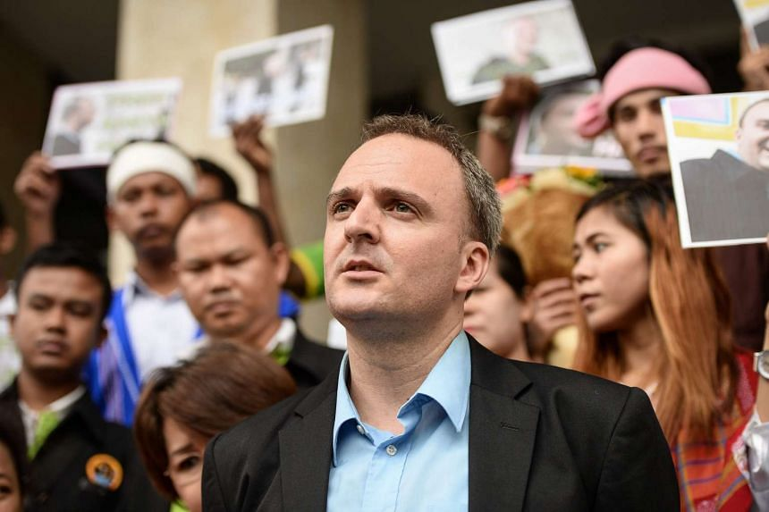 Mr Andy Hall of the Migrant Worker Rights Network was handed a three-year suspended sentence for defaming Natural Fruit Company over a 2013 report that he helped write.