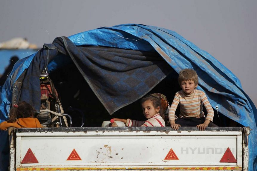 Children who fled from Islamic State-controlled areas ride a pick-up truck to the northern Syrian rebel-held town of al-Rai in Aleppo on Oct 3, 2016.