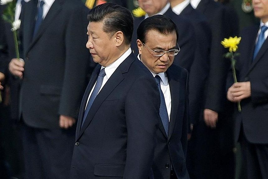 Chinese President Xi Jinping (left) and Premier Li Keqiang arriving at a tribute ceremony ahead of China's National Day last month. Mr Xi has not yet named a successor, and some analysts believe he wants to shunt Mr Li into a lesser job.