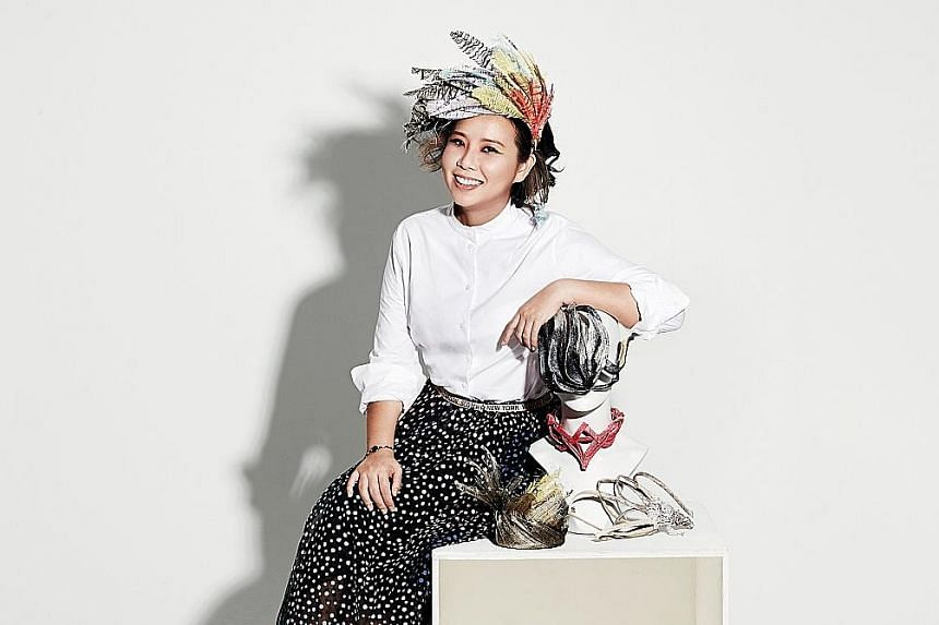 Hatter Chee Sau Fen makes hats by hand from natural fibres sourced from the Philippines.