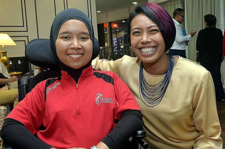 Rower Saiyidah Aisyah (right) and boccia player Nurulasyiqah Taha were among six athletes honoured for their sporting achievements.
