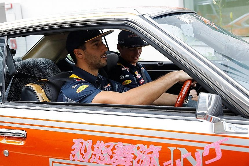 Red Bull's Daniel Ricciardo (left) driving a 1979 Nissan Skyline with team-mate Max Verstappen in the passenger's seat. The Australian will be back in the RB12 at Suzuka for Sunday's Japanese Grand Prix.