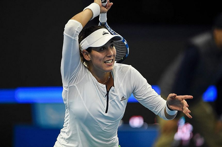 Garbine Muguruza hitting a forehand against Czech Petra Kvitova of the Czech Republic during the women's singles third round of the China Open. The second-seeded Spaniard fell in straight sets.