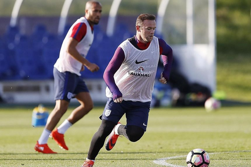 Wayne Rooney training at St George's Park with England. The 30-year-old, a substitute in Manchester United's last three games, believes he is best suited to play in midfield at this stage of his career.