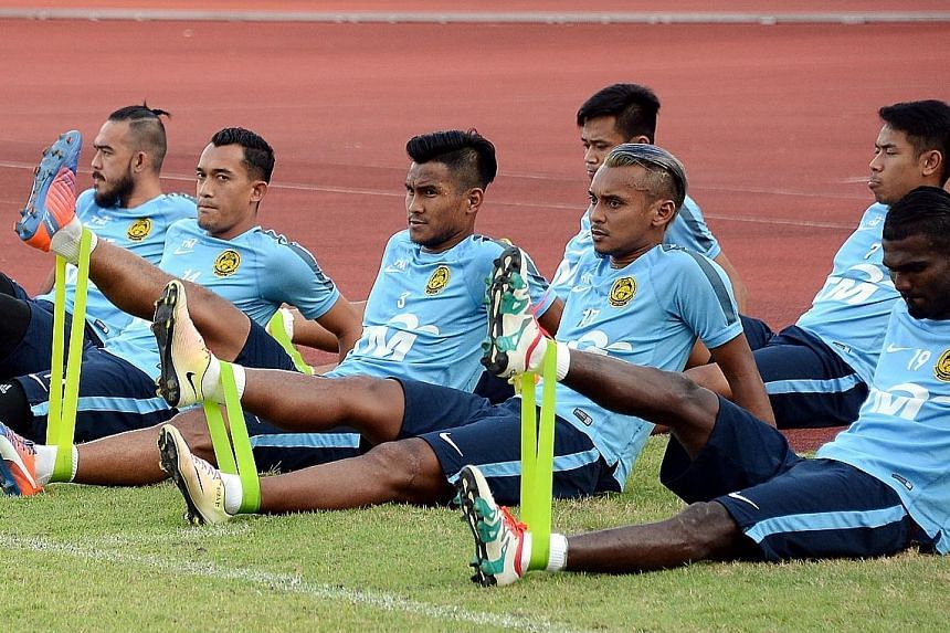 Malaysia captain, Amri Yahyah (front row, second from right) training with his team-mates at the Bishan Stadium ahead of tomorrow's Causeway Challenge.