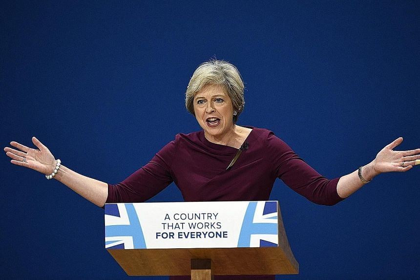 """Mrs May, speaking on the final day of the Conservative Party's annual conference, said she would make sure that everyone """"plays by the same rules"""" in Britain."""