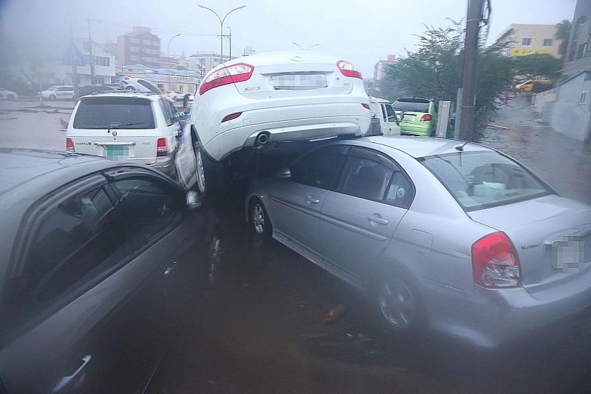 Cars were damaged as Typhoon Chaba battered Jeju island yesterday. The island and the south-western cities of Busan and Ulsan were the most severely hit by the typhoon.