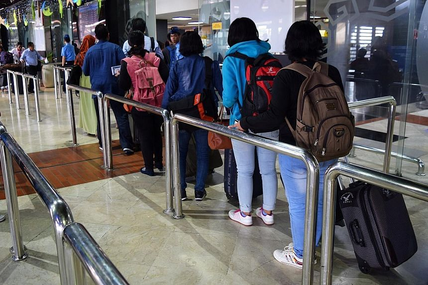 A group of Indonesian women leaving for Hong Kong from Jakarta's Soekarno-Hatta Airport to work as domestic helpers. Indonesian officials plan to visit Malaysia, Singapore, Brunei, Hong Kong and Taiwan from this month to discuss working conditions fo