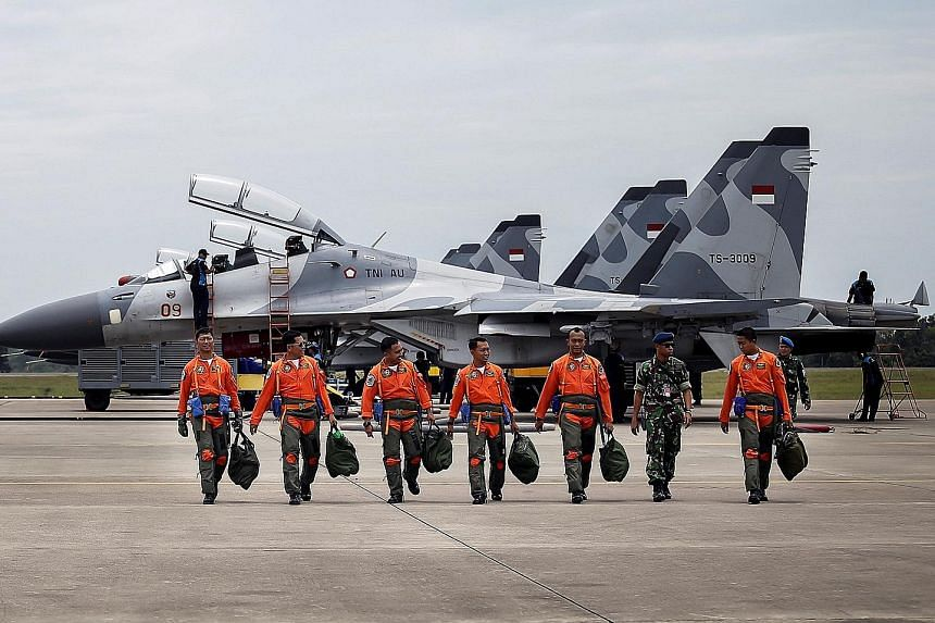 Indonesian air force Sukhoi fighter pilots and crew after training for an upcoming military exercise, at Hang Nadim Airport in Batam on Monday. Today, Indonesia will hold a major military exercise in the Natuna Islands.