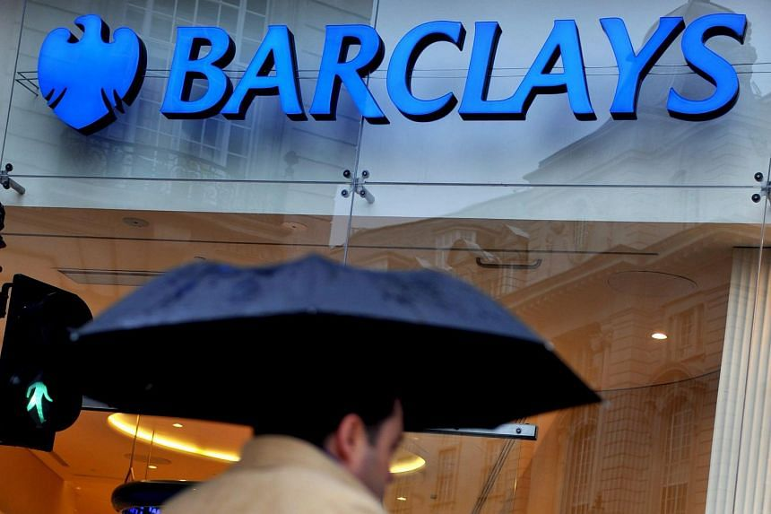 A pedestrian passing a Barclays bank branch in London, Britain.