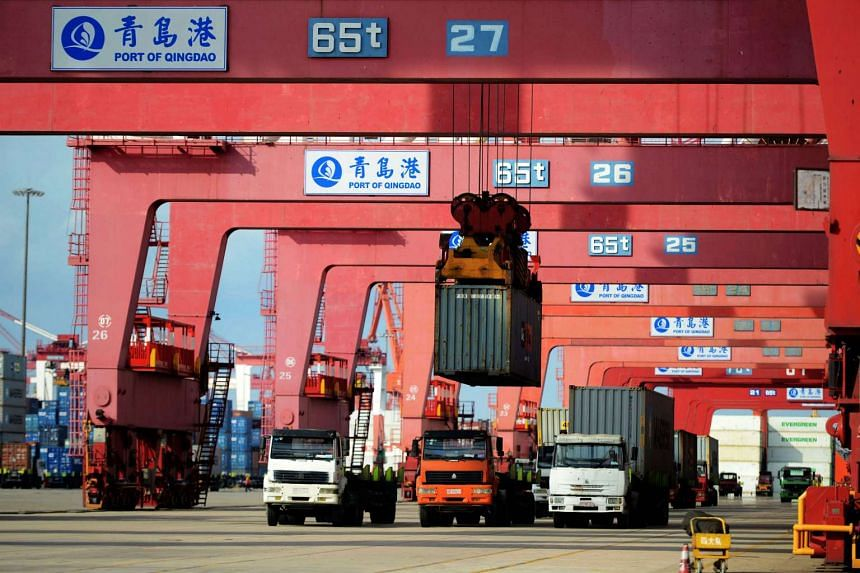 Trucks and transport containers at a port in Qingdao, China.