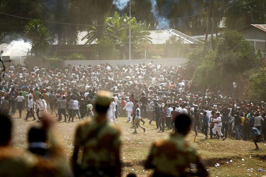 Protesters run from tear gas during the thanksgiving festival of the Oromo people in Ethiopia, Oct 2, 2016.