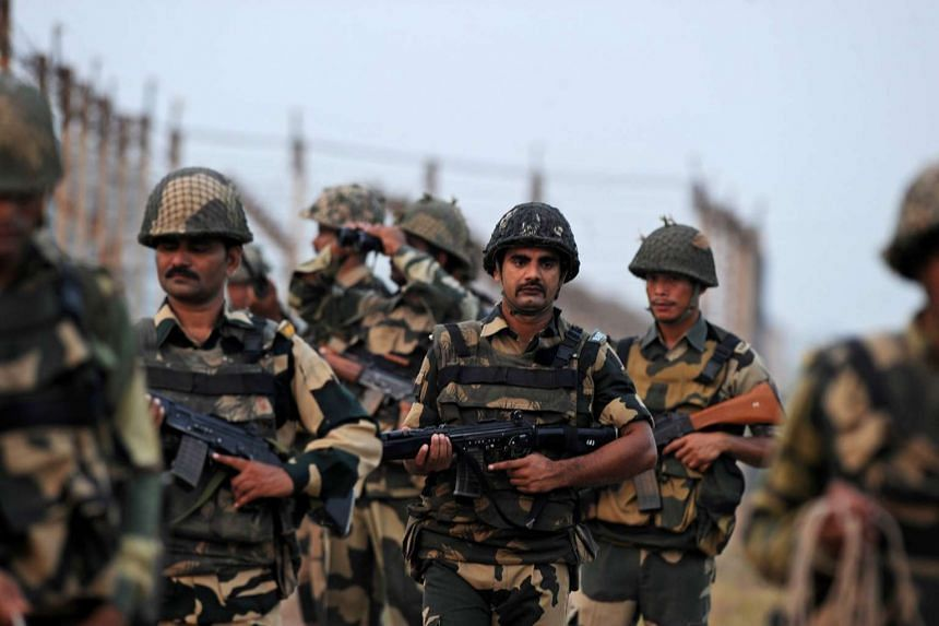 Indian Border Security Force (BSF) soldiers patrol the India-Pakistan border on Oct 3, 2016.