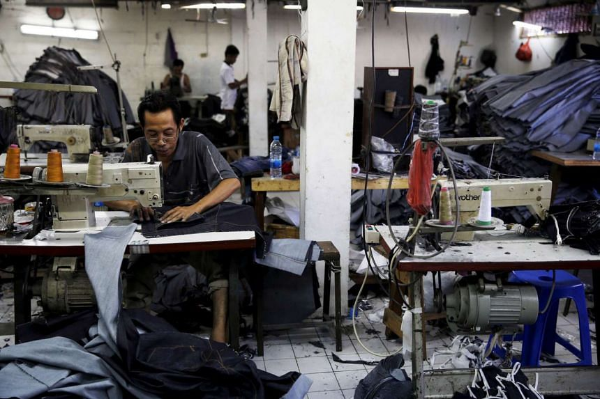 An employee stitching a pair of jeans at a small factory in Jakarta, Indonesia. While the country has comparatively few entrepreneurs, the idea of running their own businesses is gaining traction, especially among the young. The government hopes to increa