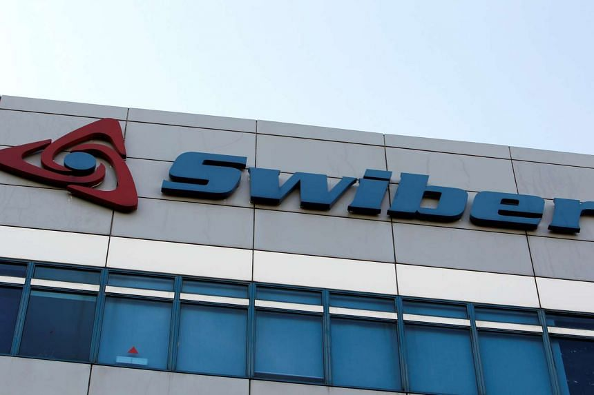 A Swiber logo is pictured at their office in Singapore.