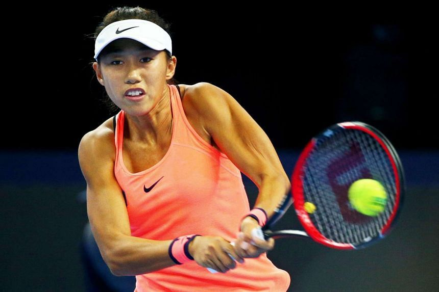 Zhang in action against Simona Halep of Romania.