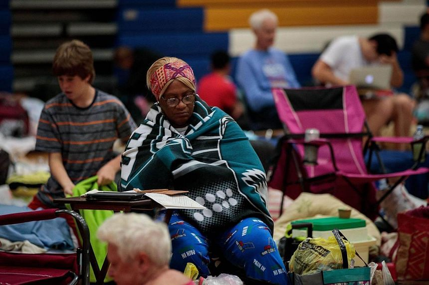 People taking shelter at Mainland High School, Oct 6, in Jacksonville, Florida.